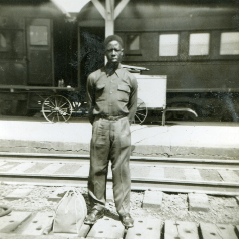 young-hank-aaron-standing-in-front-of-a-train
